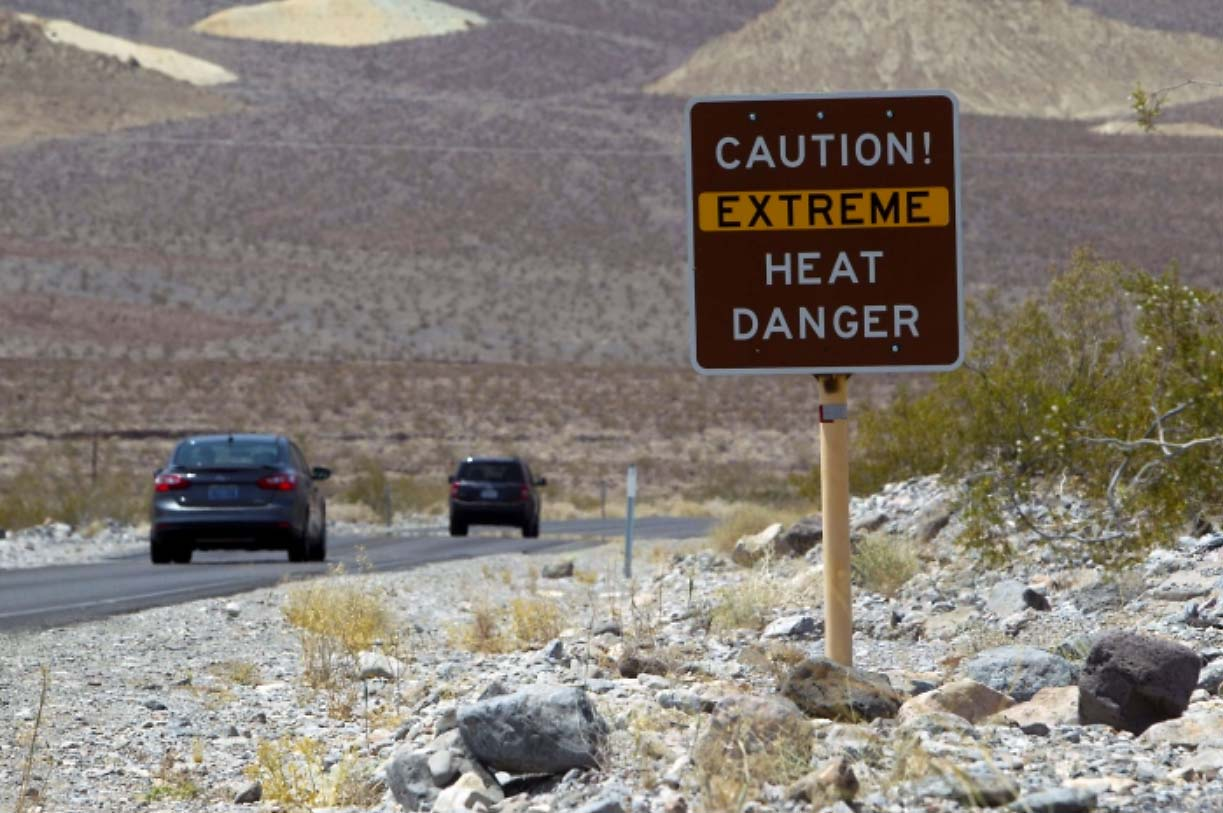 heat-dome-record-breaking-heatwave-death-valley-road-sign-extreme-warning